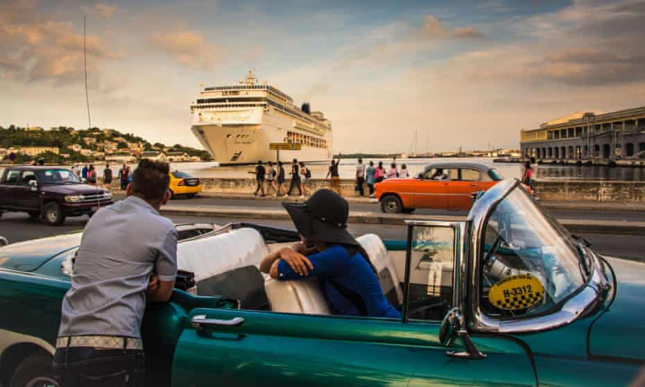 Cubans await the arrival of a cruise ship bringing tourists to Havana in 2017.