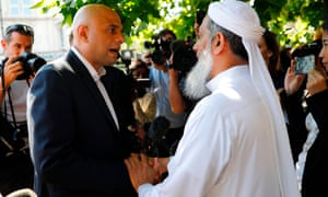 Britain's Communities and Local Government Secretary Sajid Javid speaks to a locals in the Finsbury Park area of north London