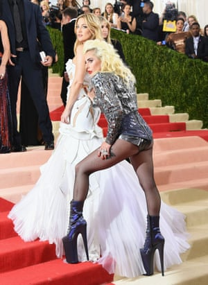 Kate Hudson and Lady Gaga This photo of Lady Gaga feeling Kate Hudson's bottom is quite weird. Not least because Hudson is the one wearing a dress, and Gaga is only in tights, and yet Gaga has shifted the spotlight onto the other bottom. WHAT DOES IT MEAN. Hudson's dress is quite fun by the standards of Hudson, who is usually a pretty dull, just-make-me-look-hot dresser. Gaga looks a bit morning-after, like someone you'd see on a fire escape having a 5am cigarette break with the party still going on inside.