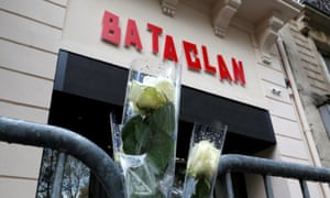 Whites roses are seen in front of the new facade of the Bataclan concert hall almost one year after a series of attacks at several sites in Paris.