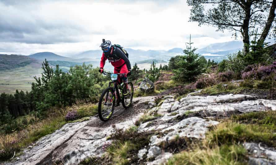 Mountain biker competing at the Laggan Wolftrax trails in the stunning scenery of the Cairngorms National Park