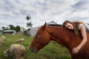 Taree, Australia. Mia Harris hugs her horse Sharny who survived the recent flooding that inundated her family home in the small township of Croki. The Australian Defence force are deploying 611 personnel across New South Wales as part of Operation NSW Flood Assist