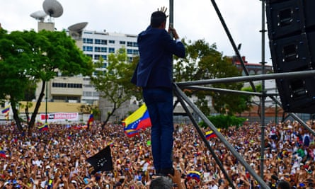 Venezuela's opposition leader, Juan Guaidó, waves to the crowd during a rally in Caracas in March.