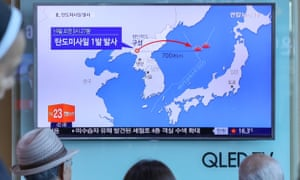 People in Seoul watch a news report on North Korea conducting a missile test launch.
