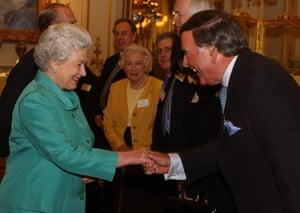 Britain's Queen Elizabeth II meets Terry Wogan