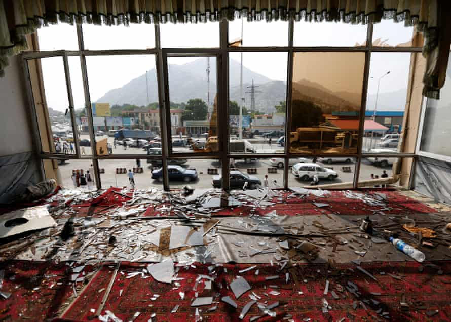 Broken glass and debris are seen inside a restaurant a day after a July 2016 suicide attack in the Afghan capital Kabul