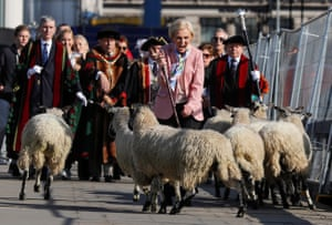 Television presenter Mary Berry is accompanied by freemen of the City of London as she opens the wool fair by walking sheep across London Bridge