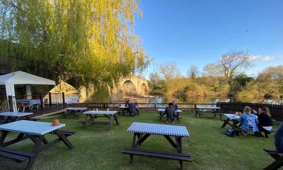 Garden, river and bridge at the Bull Inn, West Tanfield