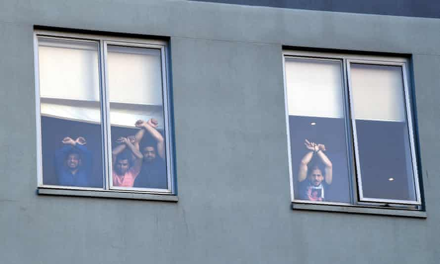 Medically evacuated refugees protest against their detention at the Mantra Hotel in Melbourne.