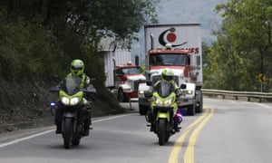Two semi-trailer trucks containing humanitarian aid from the US for Venezuela are escorted by Colombian police in Los Patios, near Cúcuta, Colombia, on Thursday.