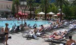 People sunbathing around a hotel pool