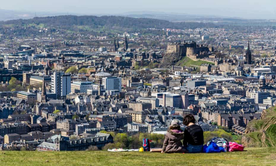 A mother and daughter enjoy a picnic atop of Arthur's Seat in Holyrood Park, Edinburgh.