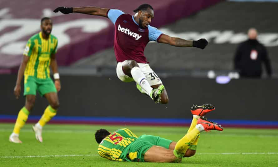 West Ham's Michail Antonio leaps over West Bromwich's Kyle Bartley in the game between the two sides in January.