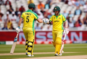 Warner and Finch touch gloves after hitting a four off the first ball.