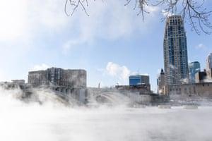Water vapor from the Mississippi River envelopes a bridge as sub-zero temperatures produce dangerous windchills in Minneapolis