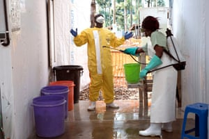 A health worker in the Katwa Ebola treatment centre exits one of the high-risk infection areas