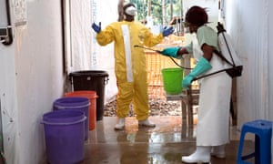 A health worker in the Katwa Ebola treatment centre exits one of the high risk infection areas