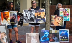 Friends and family of opioid overdose victims gathered outside of the steps of the Suffolk county superior court in Boston on 2 August while a lawsuit against Purdue Pharma was under way inside.