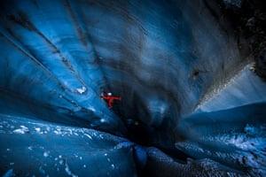 2nd Prize Alex Buisse Mer de Glace, France Jeff Mercier climbs out of a moulin, a deep crevasse formed by summer melt water, inside Mer de Glace