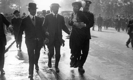 Suffragette Emmeline Pankhurst is removed from a Suffragette protest by a policeman.