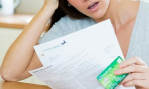a woman checks her bank balance on a statement
