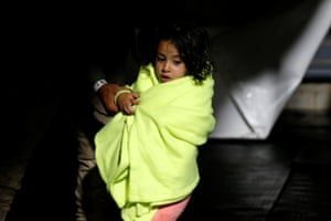 Libya, western Mediterranean Sea: A young girl is wrapped in a blanket on the German NGO migrant rescue ship Sea-Watch 3 after being rescued from a wooden boat in the Maltese search and rescue zone in international waters