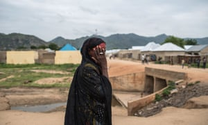 A woman covers her face in north-eastern Nigeria, an area devastated by eight years of Boko Haram's Islamist insurgency.