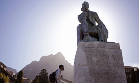 A student walks past a statue of Cecil Rhodes at the University of Cape Town in South Africa.