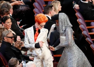 Janelle Monáe signs costume designer Sandy Powell's outfit.