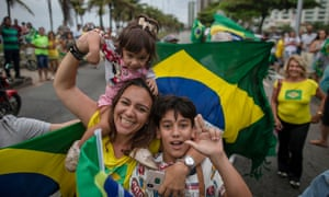 Brazilians began casting ballots Sunday in their most divisive presidential election in years.