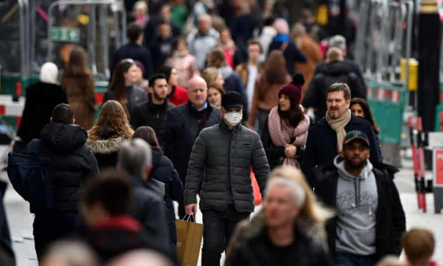 A shopper wears a protective mask on Oxford Street, central London