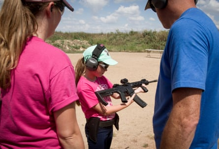 A girl tries an AR-15 rifle at the Best of the West shooting club in Austin, Texas.