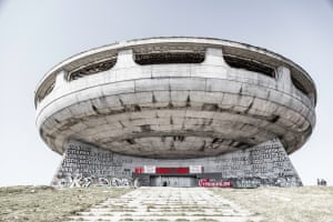 A giant, predominantly white, circular structure stands against a grey sky. The Soviet monument is on Mount Buzludzha and is the biggest ideological building in Bulgaria. It was built as a tribute to the creation of the Bulgarian socialist movement in 1891.