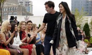 Co-creative directors of Oscar de la Renta, Fernando Garcia and Laura Kim, acknowledge audience applause from onlookers including including Nicki Minaj