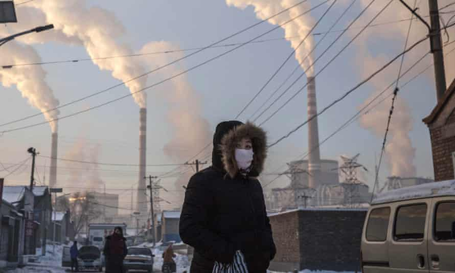 Smoke billows from industrial chimney stacks in Shanxi province, northern China