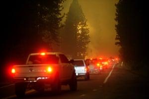 Deputies escort evacuees from the Creek fire
