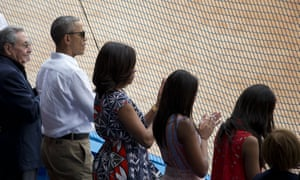 Raul Castro and the Obamas.