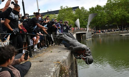 Protesters push the statue of slave trader Edward Colston into Bristol harbour during a Black Lives Matter protest rally on 7 June.