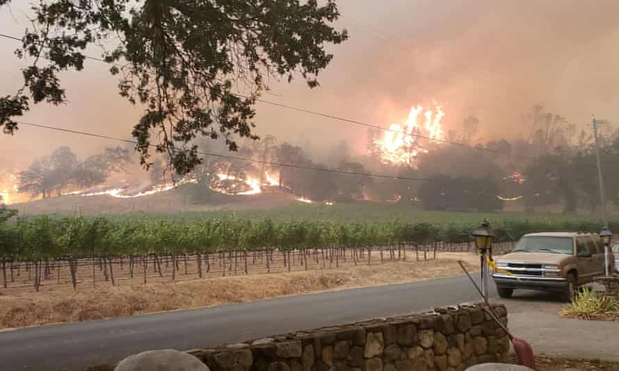 The Glass fire is seen from the front yard of a property in Calistoga, California, on 28 September.