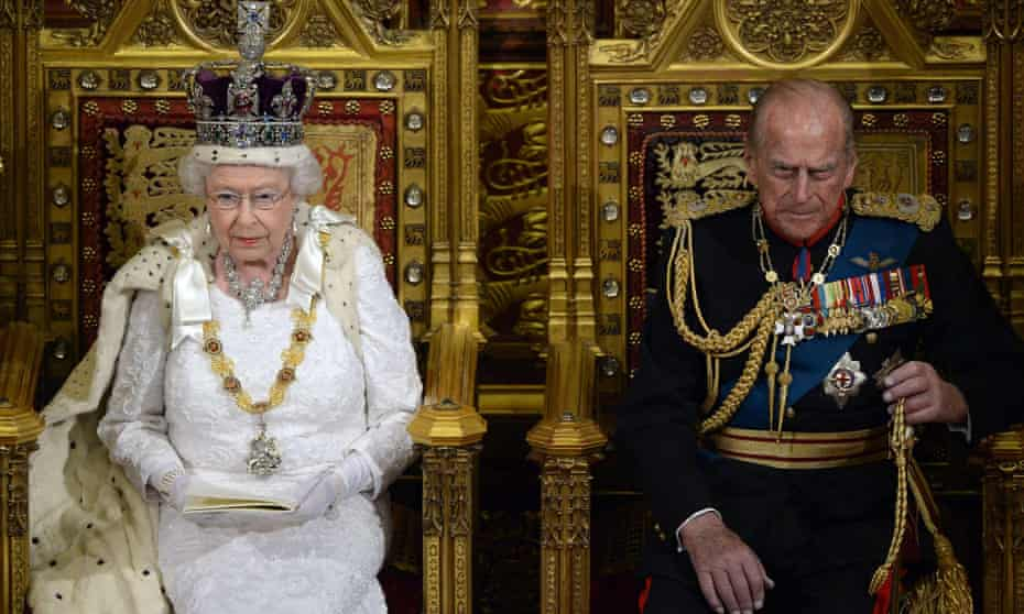 Queen Elizabeth II delivers last year's speech in the House of Lords alongside Prince Philip.