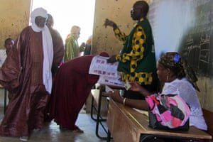 People arrive at a polling station to vote in municipal elections in Gao, Mali