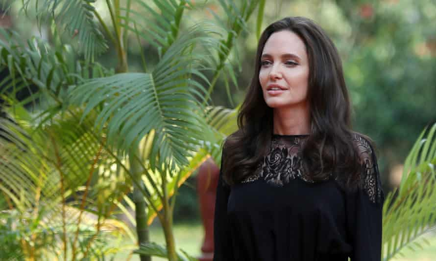 Angelina Jolie arrives for a news conference at a hotel in Siem Reap province, Cambodia.