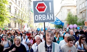 People attend a protest against the government of Viktor Orbán in Budapest