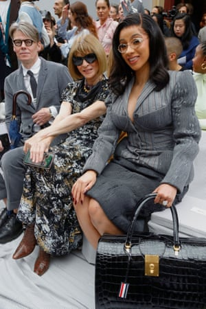 Smiling in the company of Cardi B at the Thom Browne SS20 show in Paris.