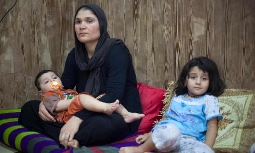 Khatwn Mirza, with her son and one of her daughters, in Sulaymaniyah. Her husband was killed when he went to find water after the family had fled to Mount Sinjar.