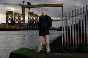 Trevor Ringland, the former Ireland and Lions player, in front of the famous cranes of the Harland and Wolff dockyard in Belfast.
