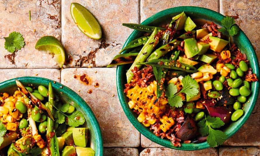 Yotam Ottolenghi's red rice salad with avocado and grilled corn. 'For a more informal look, mix the rice in a bowl with all the cooked vegetables.'