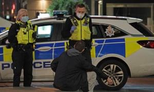Masked police officers and reveller