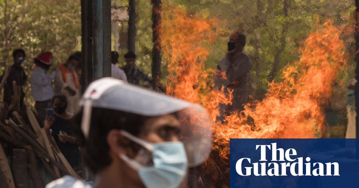 India Covid crisis: families' plea for help amid oxygen shortages and mass cremations – video report - The Guardian