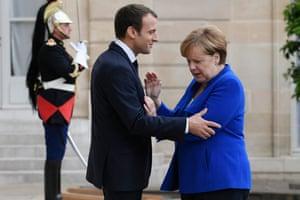 Paris, France German Chancellor Angela Merkel is welcomed by President Emmanuel Macron